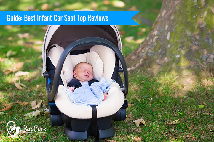 A baby sleeping in best infant car seat