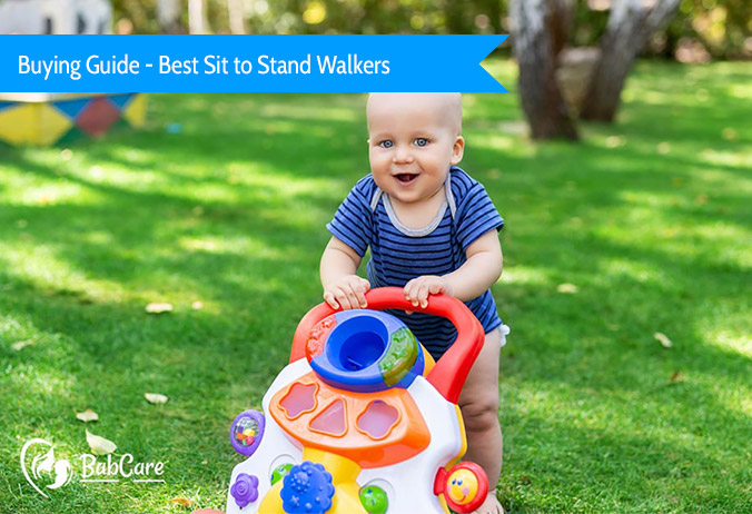 baby playing with sit to stand walker at park
