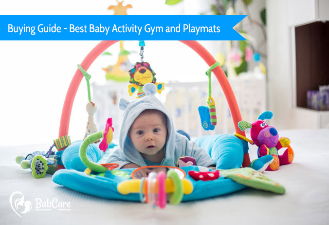 a little one playing with best baby activity gym